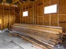 Frame house made of timber. Lumber in the pile royalty free stock photography