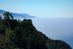 A-frame house nestled on top of cliff on  Big Sur coast Stock Photo