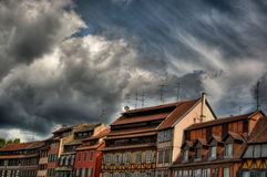 Frame Houses And Dramatic Sky HDR. August 2013, row of frame houses in Strasbourg (France), high dynamic range Stock Photo