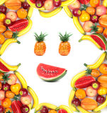 Frame of human face with assortment of various fruits Royalty Free Stock Photo