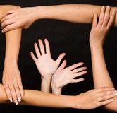 Frame of Human Hands. Hands forming a frame over dark background Stock Image