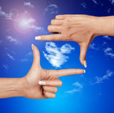 Frame from human hands against the sky Royalty Free Stock Images