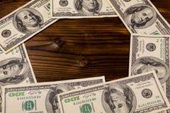 Frame of hundred dollar bills on wooden background Royalty Free Stock Image