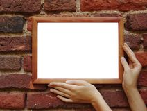 Frame In Hands On Grunge Wall Royalty Free Stock Photo