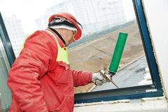 Frame insulation at windows installation Royalty Free Stock Photo