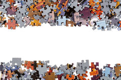 Frame of Jigsaw Puzzle Pieces. Isolated over white background Stock Photo