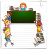 Frame with kids and a blackboard Stock Images