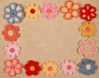 Frame of knitted flowers Royalty Free Stock Images