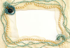 Frame of lace and jewelry. Frame of tender lace and jewelry: turquoise, pearls, coral Royalty Free Stock Photography