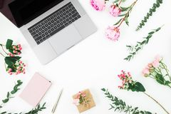 Frame with laptop, diary, pen, gift box and pink flowers and eucalyptus branches on white background. Flat lay. Top view. Feminine. Frame with laptop, diary, pen stock photos