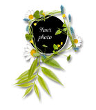 Frame from leaves and blue and yellow flowers Stock Photo