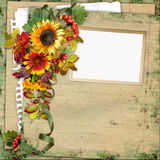 Frame with leaves and flowers on vintage background Royalty Free Stock Photography