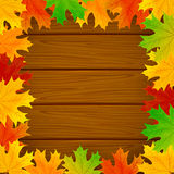 Frame from the leaves on wooden background Royalty Free Stock Photos