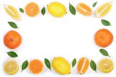 Frame of lemon and tangerine with leaves isolated on white background with copy space for your text. Flat lay, top view. Fruit composition stock photography