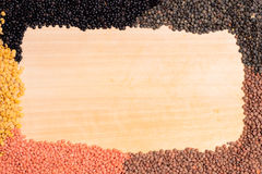 Frame of lentils on a wooden board Stock Images