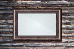 Frame on a log wall Royalty Free Stock Image