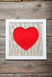 Frame with love heart on the wooden background Stock Photography