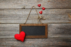 Frame with love heart on the wooden background Royalty Free Stock Photography