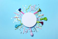 Frame made of balloons and party accessories on color background, top view. With space for text stock photo