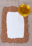 Frame made of buckwheat. On canvas Royalty Free Stock Image