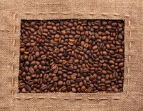 Frame made of burlap with coffee beans Stock Photos