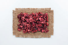 Frame made of burlap with dried cranberry Royalty Free Stock Photo