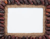 Frame made of burlap with dried dates Stock Image