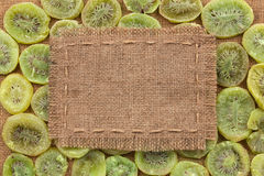 Frame made of burlap on dried kiwi Royalty Free Stock Photos