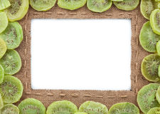 Frame made of burlap with dried kiwi Royalty Free Stock Images