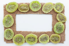 Frame made of burlap with dried kiwi Stock Photo