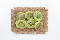 Frame made of burlap with dried kiwi Stock Photos