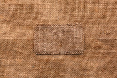 Frame made of burlap  lies on a sacking  background Stock Photo