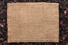 Frame made of burlap with the line lies on  hibiscus Stock Photography