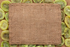 Frame made of burlap with the line lies on kiwi Royalty Free Stock Photography