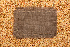 Frame made of burlap with the line lies on  peas seeds Stock Photo