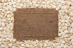 Frame made of burlap with the line lies on  pumpkin seeds Stock Image
