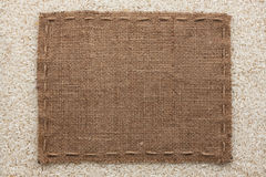 Frame made of burlap with the line lies on  rice  grains Royalty Free Stock Image
