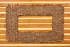 Frame made of burlap lying on a bamboo  mat Royalty Free Stock Photography