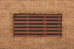 Frame made of burlap lying on a bamboo  mat Stock Photo