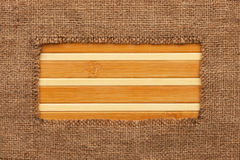 Frame made of burlap lying on a bamboo  mat Stock Photography