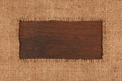 Frame made of burlap  lying on a wooden surface Royalty Free Stock Photography
