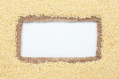 Frame made of burlap with millet Stock Images