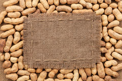 Frame made of burlap on peanut Stock Images
