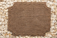 Frame made of burlap with stitches and place for your text lying Royalty Free Stock Photos