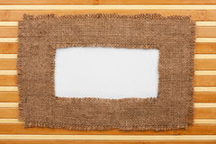 Frame made of burlap with white background lying on a bamboo mat Stock Photos