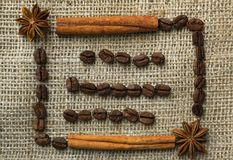 Frame made of coffee beans on traditional sack textile Royalty Free Stock Photos