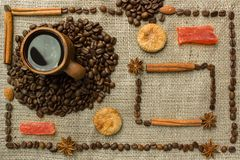 Frame made of coffee beans on traditional sack textile Royalty Free Stock Photography