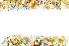Frame made of color pencil shavings on a white paper Royalty Free Stock Photography
