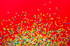 Frame made of colored confetti. Red background. Frame made of colored confetti. Red Royalty Free Stock Images