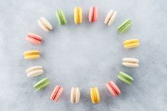 Frame made of colorful french macarons. Creative background royalty free stock photography